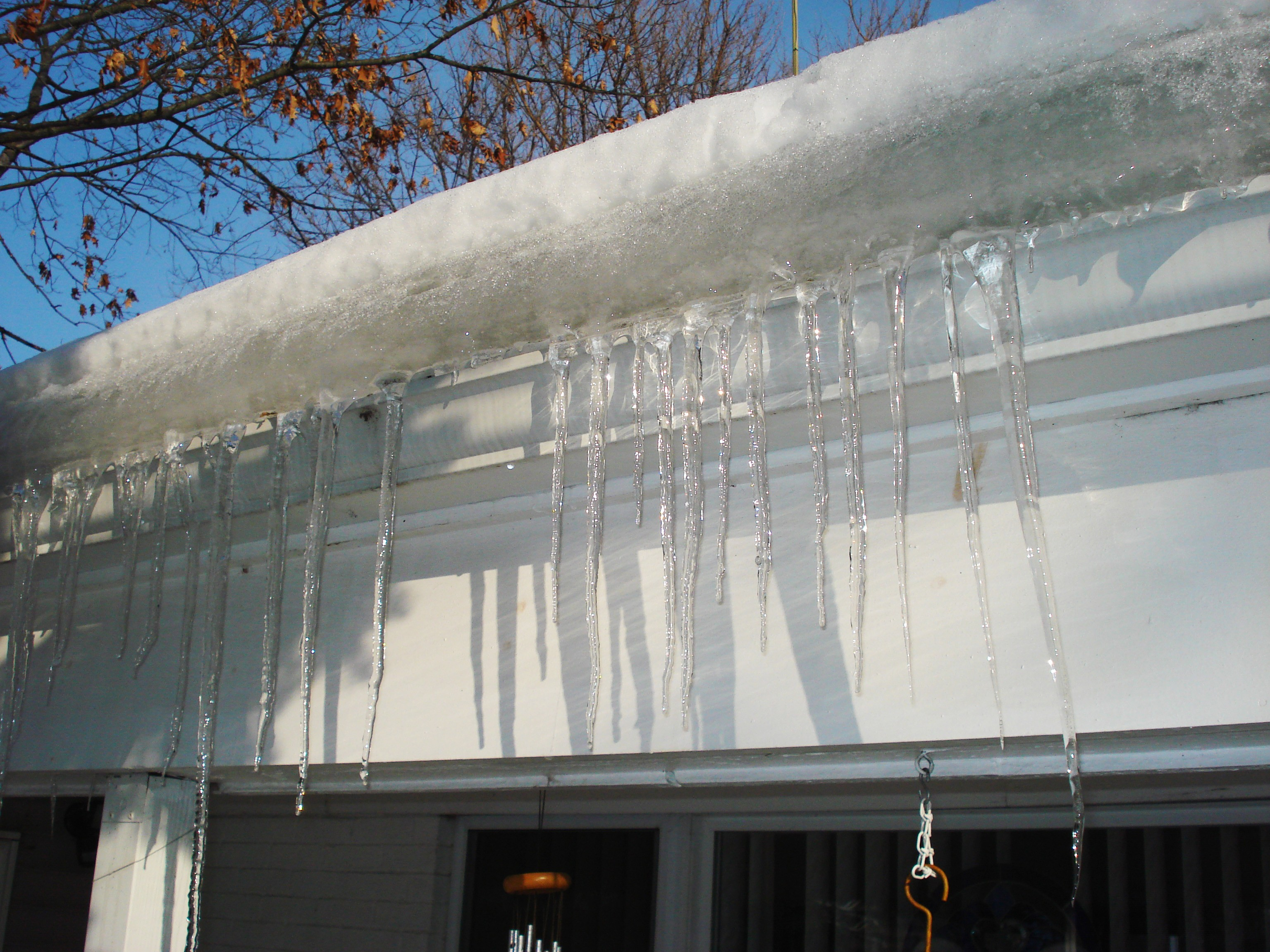 How To Remove Ice Dams From Your Roof Amp Gutters Porch Com